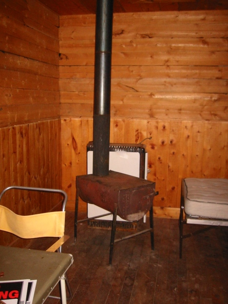 Original wood stove and grimmy floor