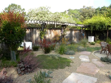 This is a gravel garden.  See Beth Chatto's gravel garden.  Arbor/fence existing