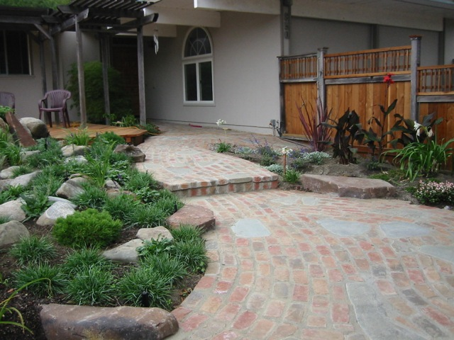 Interesting walkway that incorporates brick, stone and boulders