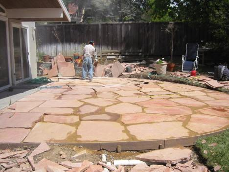 This Decomposed Granite with flagstone patio is not done correctly.  Spaces are too big and will catch high heels and chairs